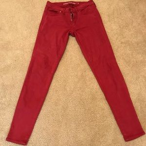 Red American Eagle skinny jeans